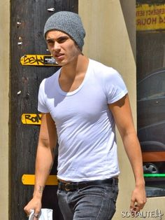 Glee cast member and Carmen Electra's boyfriend Samuel Peter Larsen is seen here getting a pack of smokes and some tacos at a Mexican restaurant in West Hollywood. August 24, 2013.