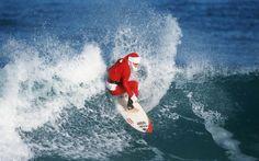Fondo Santa Claus Surfeando - Fondos de Pantalla. Imágenes y Fotos espectaculares.