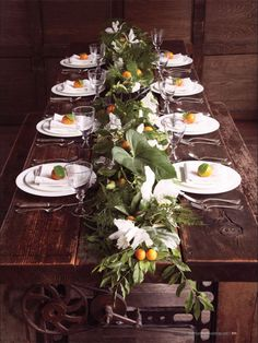 Citrus Table Garland: clementines, fern fronds and elephant leaves, white cattleya and Japanese orchids. —Martha Stewart Weddings - This is perfect! Beautiful Table Settings, Wedding Table Settings, Place Settings, Table Wedding, Wedding Reception, Table Garland, Thanksgiving Tablescapes, Deco Floral, Flower Garlands