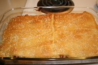 Sloppy Joe Bake 1lb ground beef 1 can sloppy joe sauce 2 cans cresent rolls 2 cups shredded cheddar cheese 1 tablespoon sesame seed