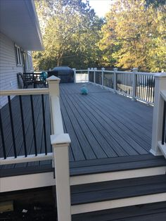 Building a deck in your backyard, garden or on your porch can do wonders for the outdoor appeal that your home has to offer. A farmhouse deck can be utilized for pretty much anything you can think of. Patio Deck Designs, Patio Design, Deck Railings, Railing Ideas, Decking Ideas, Deck Skirting, Deck Colors, Deck Stain Colors, Decking Colours Ideas