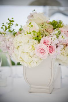 Floral centerpiece in feminine pastel hues.
