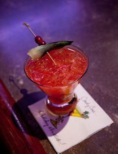 Red-Nosed Zebra: Amber Rum, Lemon Juice, Lime Juice, Agave Nectar, Strawberry Purée, Cranberries, Mint Sprigs.