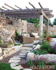 The overgrown ruins of an old barn was transformed into a courtyard terrace and pool. | Photographer: Virginia MacDonald Garden Design: Sheilagh Crandall