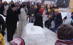 Churchpop.com   Stranded Pro-Life Group Builds Snow Altar, Holds Mass on Highway Shoulder