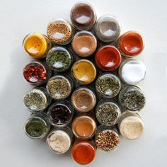 """Everything Hex Wall Set--""""These all-natural spices and salts from Gneiss Spice are stored in reusable magnetic jars, so flavorful meats and zesty veggies are always within reach. The deliciously convenient sets can also be ordered empty to accommodate your own special seasonings."""""""