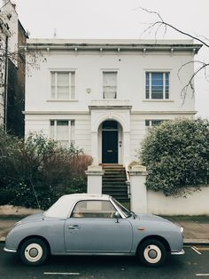 vintage tiffany blue car and classic white home in notting hill, london