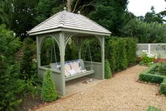 Swing seat arbour, painted. The Garden Trellis Company. Perfect for any weather. Great focal point too.