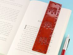 This hand-tooled leather bookmark has hand-stamped Bulldogs and a hand-tooled border. This leather keychain would also make an ideal leather gift. Also, handcrafted leather goods make great anniversary gifts. Why not check out my Etsy shop? Leather Gifts, Leather Books, Leather Craft, Handmade Leather, Leather Anniversary Gift, Anniversary Gifts For Parents, Husband Anniversary, Book Lovers Gifts, Dog Lover Gifts