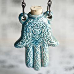 This stunning Hamsa hand (pendant) is a Raku style Peruvian ceramic bottle Hand Der Fatima, Hamsa Hand, Tattoos, Jewelery, Women's Jewelry, Perfume Bottles, Clay, Handmade, Gifts