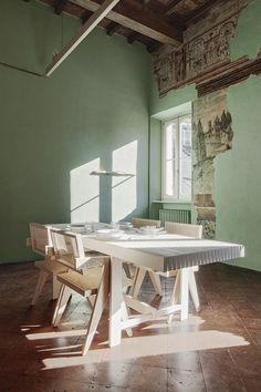 Faded frescos offer a backdrop to contemporary furnishings in Brolettouno Apartment, a holiday home in northern Italy that has been refurbished by local studio Archiplan Art Furniture, Custom Furniture, Home Upgrades, Fresco, Dining Area, Dining Table, Dining Rooms, Traditional Tile, Stucco Walls