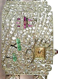 Exquisite Art Deco watch; diamonds, emeralds and rubies.-------------- I see Hello Kitty.  Do you?