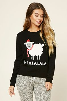 "A ribbed knit PJ sweater featuring a ""Balalalala"" holiday sheep graphic, a round neckline, and long sleeves."
