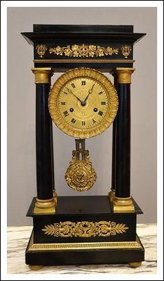 Orologio impero legno ebanizzato e bronzo dorato al mercurio