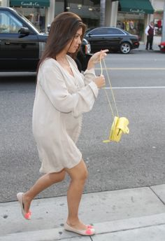 Umm...Kourtney...normally I think you're gorgeous. But, wearing an oversized shirt as a maternity outfit is not attractive.