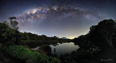 Milky Way Over Piton de l'Eau (June 25 2012)  Image Credit & Copyright: Luc Perrot Sometimes, if you wait long enough for a clear and moonless night, the stars will come out with a vengeance. One such occasion occurred earlier this month at the Piton de l'Eau on Reunion Island. In the foreground, surrounded by bushes and trees, lies a water filled volcanic crater serenely reflecting starlight. A careful inspection near the image center will locate Piton des Neiges, the highest peak on the…