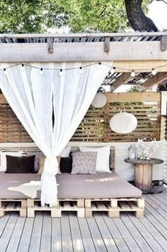 Love the white. The use of pallets. The old wagon wheel thing as a table. good good. Outdoor Rooms, Outdoor Living, Outdoor Beds, Outdoor Bedroom, Outdoor Lounge, Outside Living, Pallet Ideas, Diy Pallet, Pallet Furniture