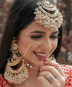 Add a little glam to your Indian wedding outfit by wearing these chic earrings. You can pair these trendy and classy earrings with any ethnic attire. OTT earrings will surely take your reception/haldi/mehndi/wedding outfit a notch higher. Indian Jewelry Earrings, Indian Jewelry Sets, Fancy Jewellery, Jewelry Design Earrings, Nose Jewelry, Stylish Jewelry, Bridal Earrings, Fashion Jewelry, Jewelry Box