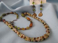 """Kumihimo  Handmade Seed Beaded Set - Necklace 27""""  Pendant 2 1/2""""  Earrings 3"""" (wire hooks) - Green,Brown,Gold Beads- Multi color Seed Beads by LsFindsandCreations on Etsy"""