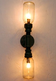 Industrial Wall Sconce, plumbing pipe repurposed industrial lighting. $110.00, via Etsy.