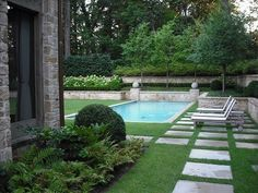 Love the square stepping stones with grass between..Simply Elegant