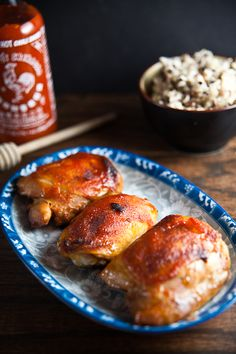 Updated: Honey + Sriracha Chicken Thighs | Healthy. - These were really good, but VERY spicy (we like spice!). If you don't you may want to reduce the sriracha.