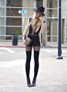 Thigh-high socks are the sexiest addition to a fashionistas outfit you could have. The American Apparel top is everywhere!