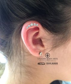 Macy stopped in for a piercing and asked for help in choosing what to get. She has an awesome ridge on the top of her ear that allowed us room not only for a unique piercing, but also the shape and space needed for this anatometal cluster to comfortably fit and flow with her anatomy. Thanks so much for letting us do this fun piercing, Macy!