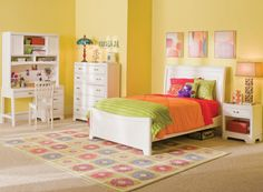 Colorful and quaint! Use bright accessories in your kids room to create an inspirational space.