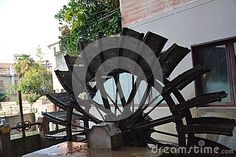 The unique watermill in action a Treviso, north Italy, Europe.
