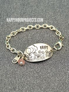 Floral Scene Stamped Bracelet at www.happyhourprojects.com #DIYJewelry #MetalStampedJewelry #thursDIY