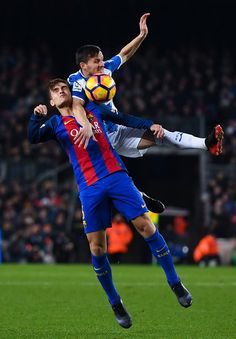 Denis Suarez of FC Barcelona competes for the ball with Pablo Piatti of RCD Espanyol during the La Liga match between FC Barcelona and RCD Espanyol at the Camp Nou stadium on December 18, 2016 in Barcelona, Catalonia.