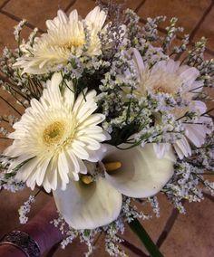 Bridesmaids bouquet: Gerberas, Limonium and arum lilies