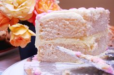 Champagne Cake -Champagne Cake  (adapted from Booze Cakes)  3 cups all-purpose flour +  3 tsp. baking powder +  1/2 tsp. salt +  1 cup (2 sticks) unsalted butter +  2 cups sugar +  1/4 tsp. LorAnn champagne flavoring oil (or 1 tsp. pure vanilla extract) +  6 egg whites +  2 cups champagne