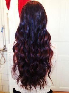 burgundy hair color and spiraled hair wand waves