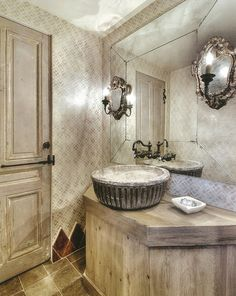 Prior to indoor plumbing, the French used a vasque (basin) to hold water for washing. Here a 19th c. vasque from a a Provençal cottage finds new life as a sink in designer Cindy Witmer's charming bath.