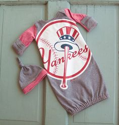 I'm not really a sports fan, in general but I do like this. It's so cute! ~~~ YANKEES Baby Layette Gown with Hat by VintageDuck on Etsy