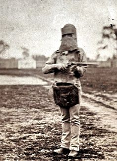 Policeman posing in suit of Kelly Gang armour with Ned Kelly's (the armoured outlaw) rifle and silk cap (June Famous Outlaws, Australian Painting, Australian Artists, Ned Kelly, The Lone Ranger, Aboriginal People, Old West, Historical Photos, Vintage Images