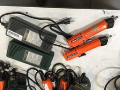 POWER TOOLS HIOS BLG-5000 ELECTRIC SCREWDRIVERS WITH POWER ADAPTERS. ONLY ONE CORD.
