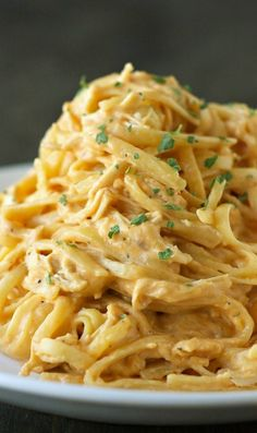 Crockpot Cheesy Buffalo Chicken Pasta. A little kick to this pasta will set your tastebuds in motion:)