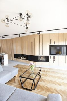 Timber Terrace - a home with light furnishings and wood paneling, featured on NONAGON.style