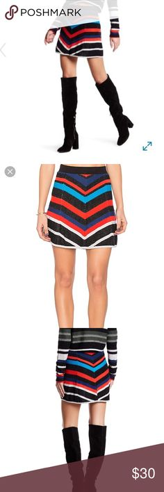 Free people black combo knit striped skirt Free people black combo knit striped skirt. The colors are vibrant with black outline. Comfy with elastic waist. Has a mod feel to it. Love it with the long boots pictured. Free People Skirts