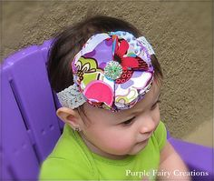 """Fabric flower is embellish with a light green sparkly rhinestone cluster in the center. Flower measures approx. 3.5"""", backed with felt for extra comfort on your little ones head and is securely attached to a ivory lace (1"""" wide) headband. $6.00"""