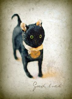Antique black cat toy. This would be super cute Halloween decor.