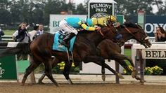 Union Rags nipped Paynter at the wire in a photo finish Saturday to win the Belmont Stakes. (via AP)