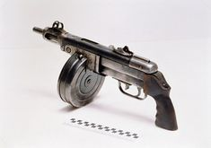 "The PPSh-41 (Pistolet-Pulemyot Shpagina; Russian: Пистолет-пулемёт Шпагина; ""Shpagin machine pistol"". Cartridge: 7.62x25mm Tokarev."