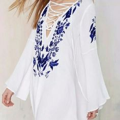 Beautiful embroidered white bikini coverup. Brand new white  coverup with blue embroidered details. Made of cotton. One size fits most from S to L. Length 30in; bust 40 in; hip 50; sleeve 22 in. Swim Coverups