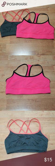 Two Champion Sports bras One black and pink reversable and one crossed back sports bra Champion Intimates & Sleepwear Bras