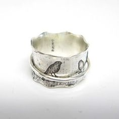 Beautiful silver ring with a little bird, which is perfect for me, and the icing on the cake, is that it's a spinner ring.