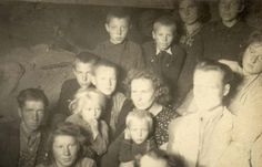 """Deported Lithuanians on their way to Siberia in a cattle wagon in 1951. 70% of all those deported were women and children. These people were told they were to be deported: """"to remote regions of Siberia for the rest of your life""""."""